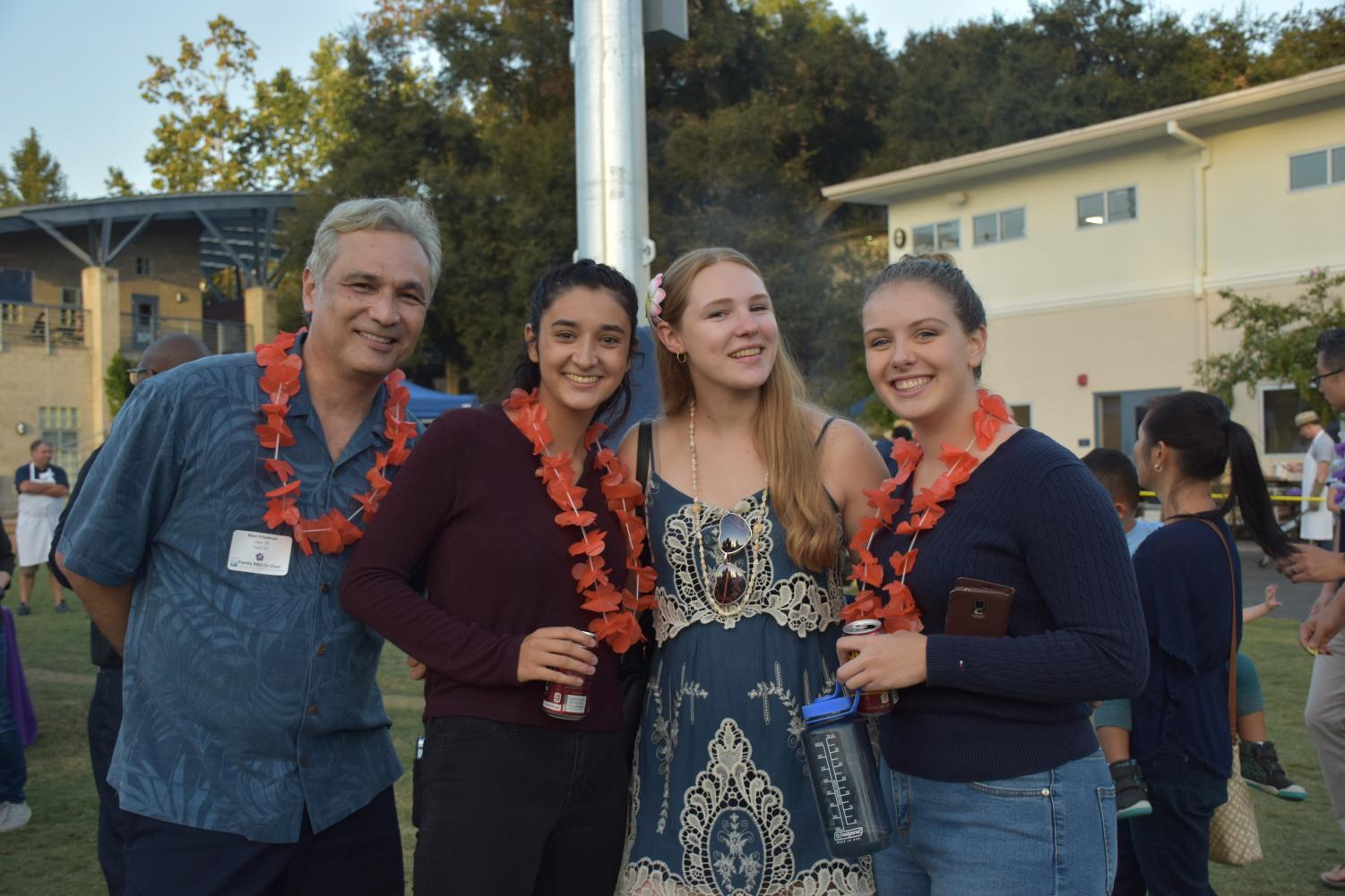 Mr. Friedman, Lara Friedman '19, Sinclaire Ledahl '19 and Danielle Maxwell '19 at the family BBQ.