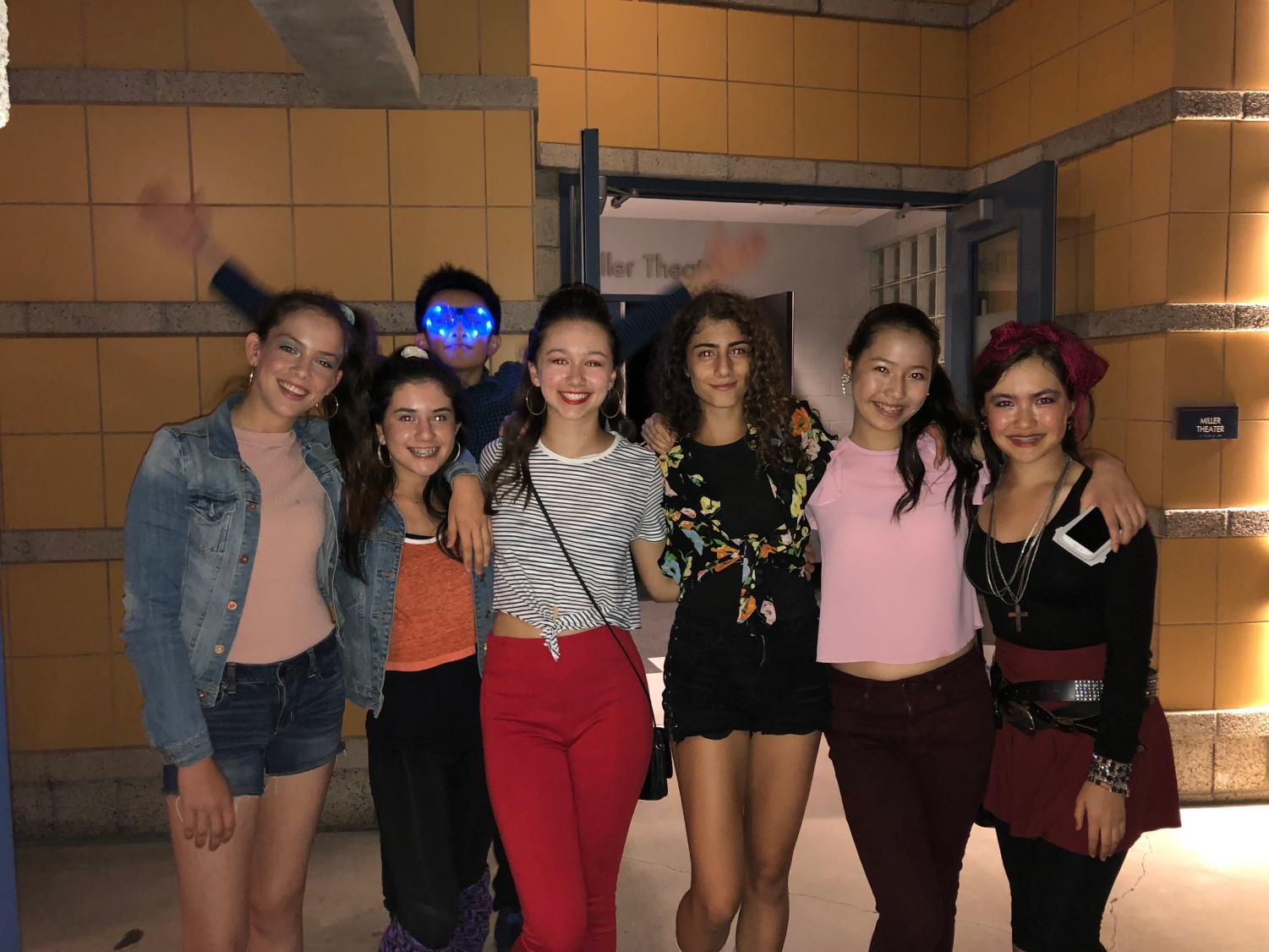 Ethan Wong '21 photobombs Ella Johannes '21, Maya Le '21, Madison Jaffrey '21, Silvia Ioannou '21, Elaine Cheng '21, and Claire Senft '21 as they pose for a picture at the Decade Dance.