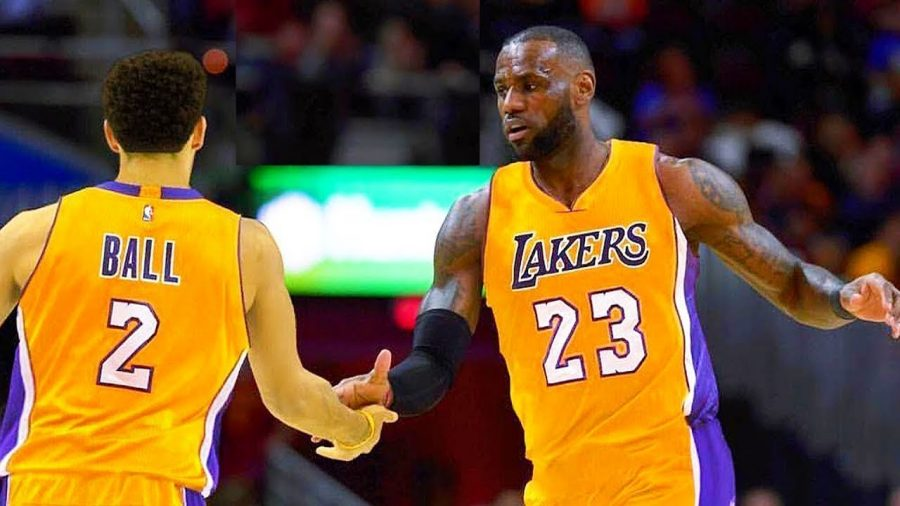 Lebron+James+giving+teammate+Lonzo+Ball+a+high+five.