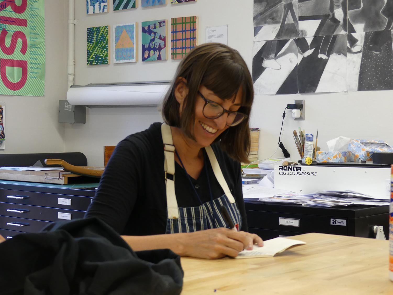Ms. Manfull, AP Studio Art teacher, draws along with her class.