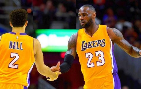 Lebron James giving teammate Lonzo Ball a high five.