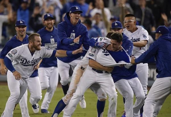 Cody Bellinger celebrates after hitting a walk-off hit