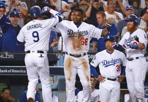 Yasmani Grandal and Yasiel Puig celebrating in Game 3 of the NLDS.