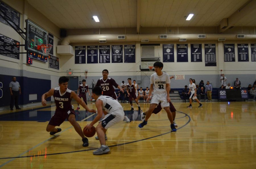 Zach Luu '21 and Torres Shi '19 run a pick and roll play.