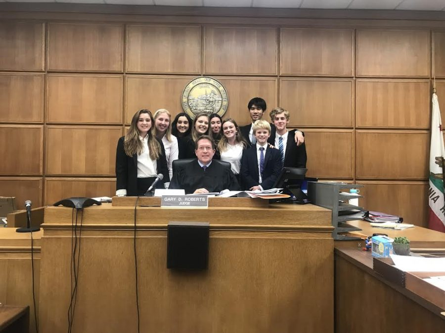 The+Mock+Trial+team+poses+at+the+courthouse.