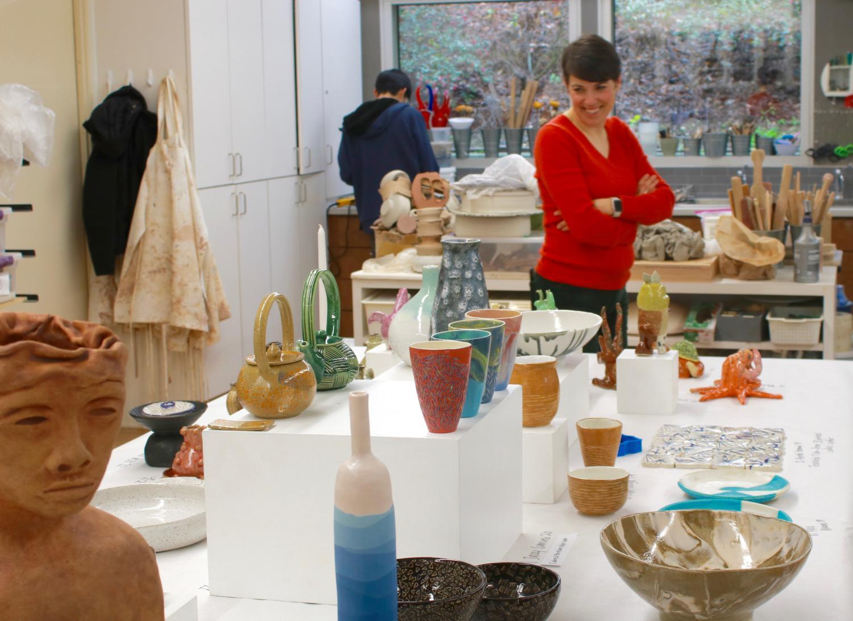 Photo courtesy Ani BernardiCeramics teacher Ms. Popova admires the pieces on display at the art exhibit.