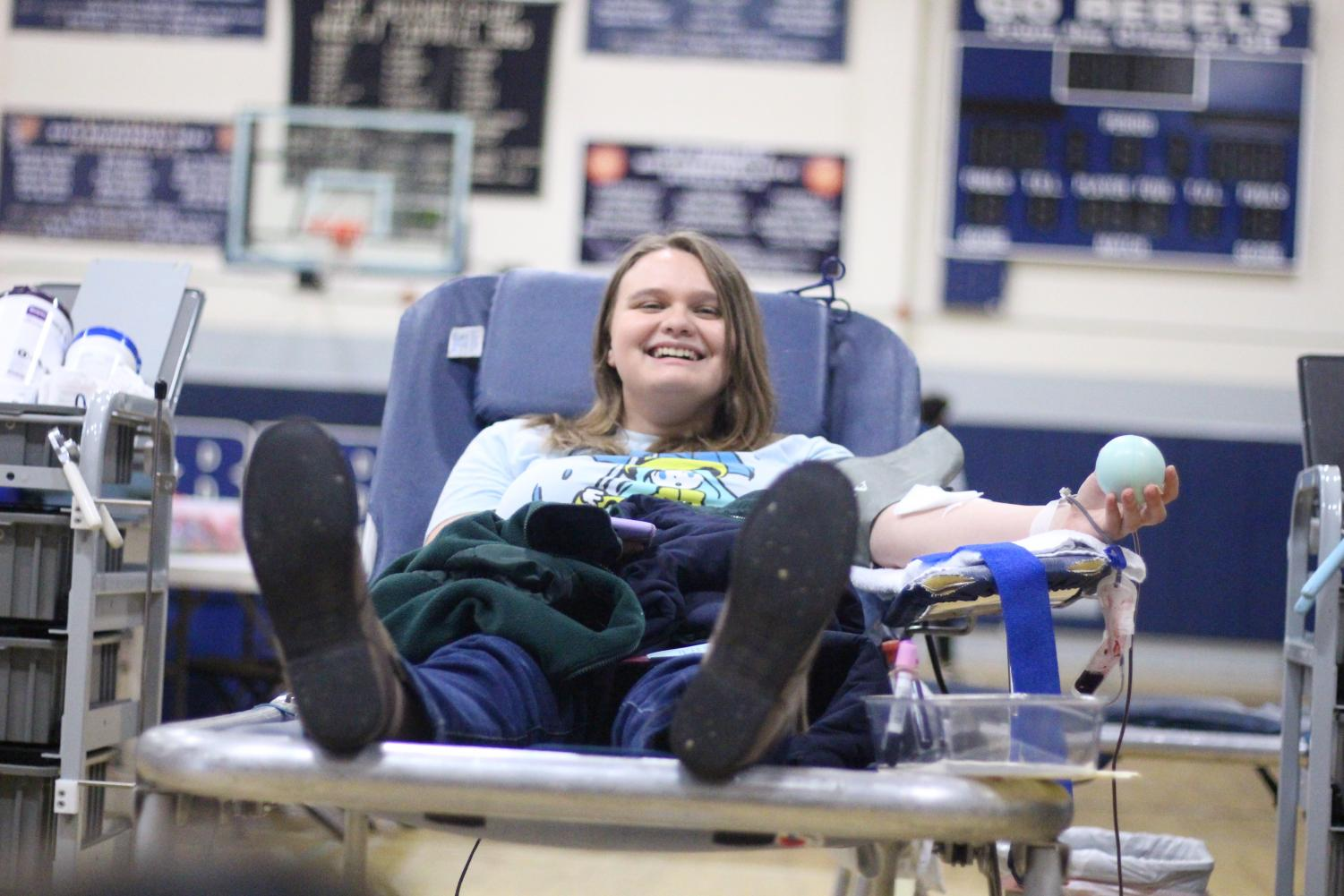 Lindsay Browne '20 donates blood at the blood drive.