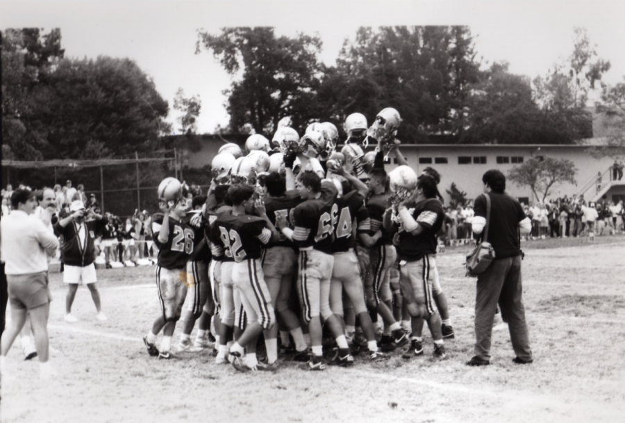 Rebel+football+players+meet+in+a+huddle+in+this+archival+photo+from+the+1980s.