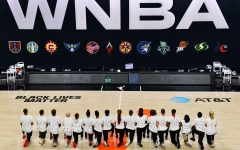 WNBA players kneel during the National Anthem to protest police brutality against African Americans in America