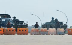 Soldiers guard a blocked road near Myanmar's parliment in Naypyidaw on February 1